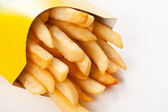 French fries on a white background — Stock Photo