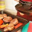 Beef steak in a frying pan — Stock Photo #13901418