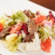 Salad with beef and grapefruit - Stock Photo