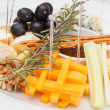 Cheese plate with grapes and honey — Stock Photo