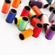 Stock Photo: Bobbins of lurex thread