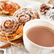 Cinnamon rolls with cocoa — Stock Photo #14888933