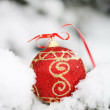 Red ball on the snow - Stock Photo