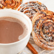 Cinnamon rolls with cocoa — Stock Photo #15695263