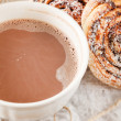 Cinnamon rolls with cocoa — Stock Photo #16354471