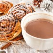 Cinnamon rolls with cocoa — Stock Photo #16956013