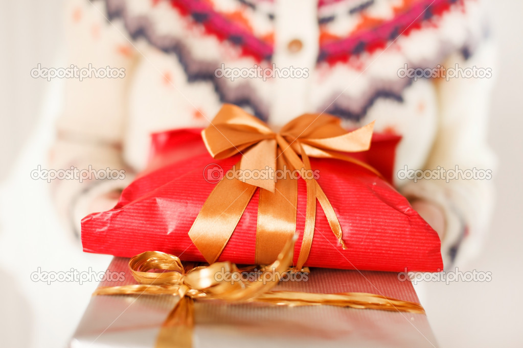 Woman holding presents  Stock Photo #17487119