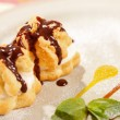 Profiteroles with ice cream - Stock Photo