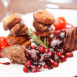 Stock Photo: Beef steak with potatoes and cranberry sauce