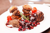 Beef steak with potatoes and cranberry sauce — Stock Photo