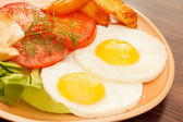 Fried eggs with vegetables — Stock Photo