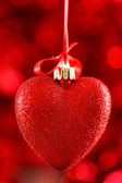 Red heart on ribbon — Stock Photo