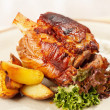 Stock Photo: Roasted pork knuckle with potatoes