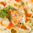 Pasta with salmon and caviar — Stock Photo