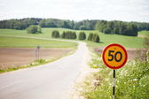 Limit sign near road — Stock Photo