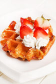 Belgian waffles with fresh strawberries and whipped cream — Stock Photo