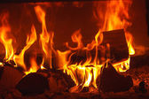Fire in fireplace — 图库照片