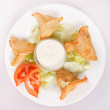 Samosa with sauce — Stock Photo