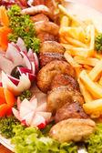 Kebab on skewers — Stock Photo