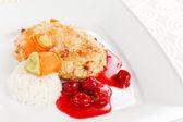 Chicken with cherry sauce — Stock Photo