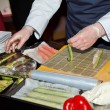 Chef preparing sushi in the kitchen — Foto Stock