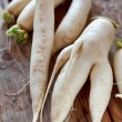 Daikon radish on the wood background - Stock Photo