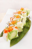 Tasty sushi with avocado — Stock Photo