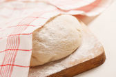 Dough on wooden board — Stock Photo