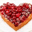 Sweet cake in heart shape — Stock Photo #24907501