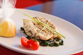 White fish with spinach — Stock Photo