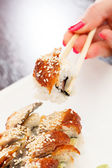 Sushi with chopsticks — Stock Photo