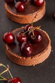 Chocolate tart with cherry — Stock Photo