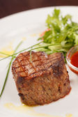 Grilled steak with sauce — Stock Photo