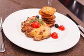 Meat with potato pancakes — Stock Photo