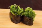 Japanese fresh maki sushi with chuka salad — Stock Photo