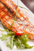 Salmon steak with potatoes — Stock Photo