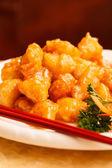 Comida china. pollo con salsa agridulce — Foto de Stock