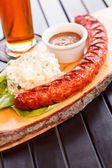 Sausage with salad — Stock Photo