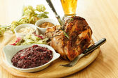 Eisbein with braised cabbage, mashed potato, and beer — Stock Photo