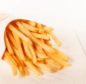 French fries in a paper wrapper — Stock Photo