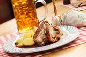 Pork with potatoes and beer — Stock Photo
