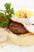 Fried egg with steak and potatoes — Stock Photo