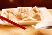 Jiaozi - Chinese dumplings filled with pork and spring onions. — Stock Photo