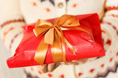 Woman holding presents — Photo