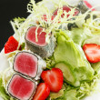 Salad with tuna and strawberry — Stock Photo