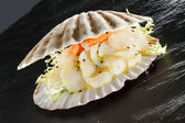 Scallops served in a shell — Stock Photo