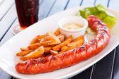 Sausage and potatoes — Stock Photo