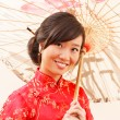Stock Photo: Chinese womwith umbrella