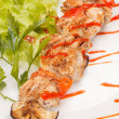 Chicken kebab with tomato sauce — Stockfoto