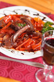 Grilled ribs with vegetables — Stock Photo